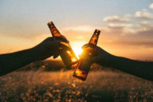 Toasting beers in the sunset